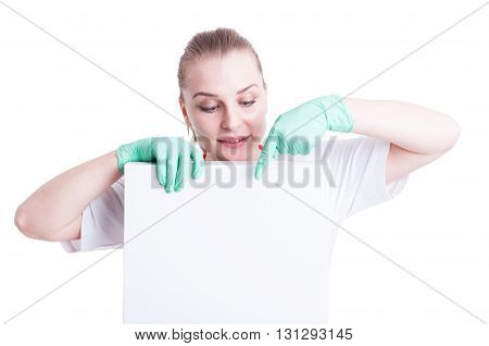 Portrait Of Young Beautiful Doctor Holding A Blank Box