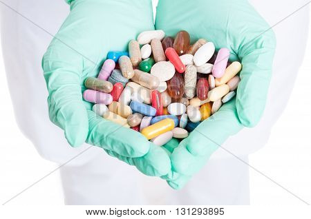 Close-up Of Many Pills, Capsules And Tablets In Doctor Hands