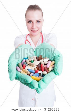 Young Smiling Doctor Holding Many Pills In Her Palms
