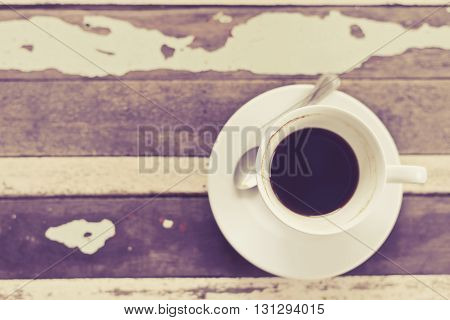 top view of coffee cup on grunge wooden table in vintage style