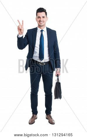 Businessman Wearing Blue Suit And Briefcase Showing Peace Gesture