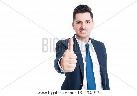 Confident Young Businessman Wearing Blue Suit Showing Like Gesture Smiling