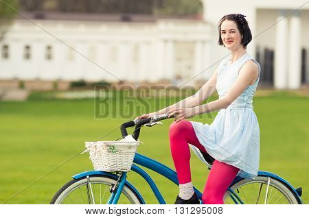 Beautiful Happy Woman With Bicycle In The Park Relaxing
