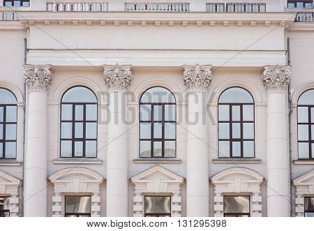 facade of an old building with columns and windows.