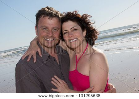 Caucasian Man And Woman Under A Blue Sky On A Beach