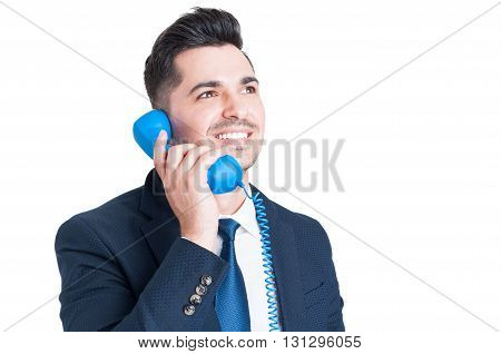 Close-up Of Successful Happy Businessman Talking On Retro Phone