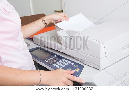 Close Up Of A Young Secretary Using A Copy Machine