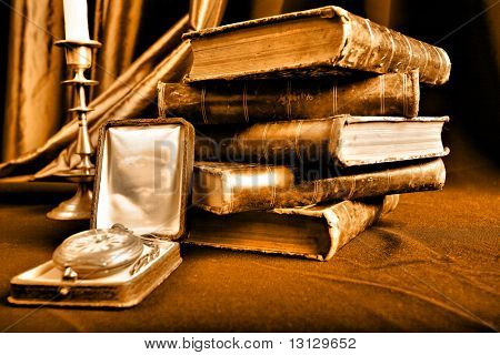 Style art background. Vintage books and candles.