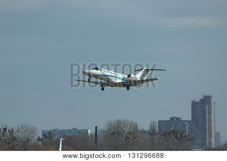 Kiev Ukraine - March 24 2011: Cessna 525B Citation Jet CJ3 is taking off from the airport with city on the background