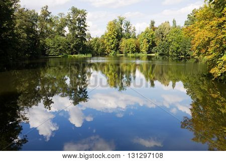The scenic pond in Arkadia park in Poland. The Arkadia park is the known romantic English landscape garden in Poland.