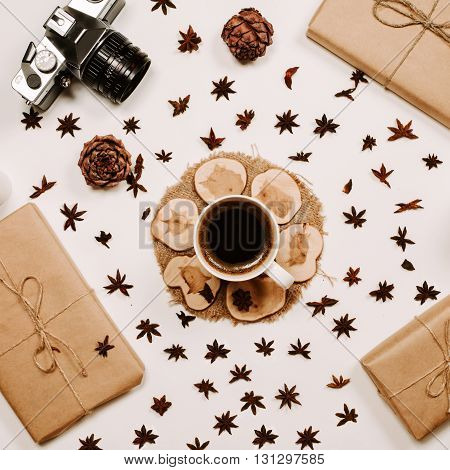 Cup of coffee, milk and dried flowers at white background. Flat lay, top view