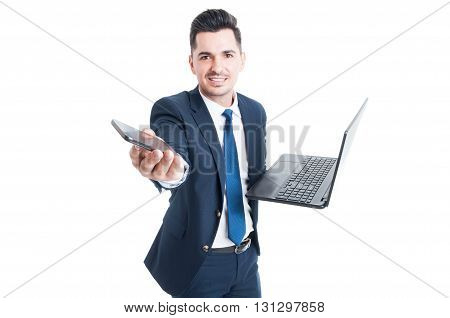 Happy Salesman Holding Laptop And Smartphone As Multitasking Concept