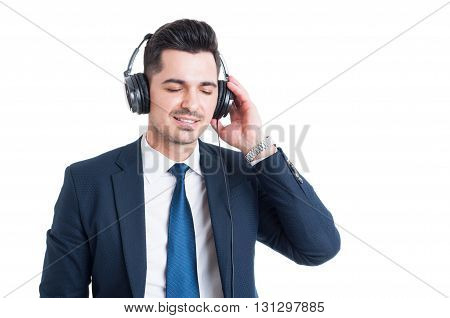 Beautiful Young Businessman Enjoying Music On Headphones And Relaxing