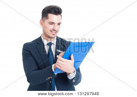 Handsome Happy Businessman Or Banker Taking Notes On Clipboard