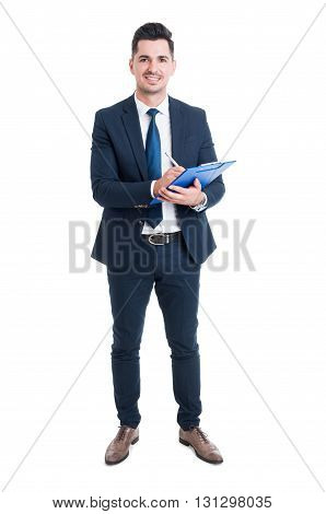 Full Body Of Smiling Businessman Holding Blue Clipboard And Writing