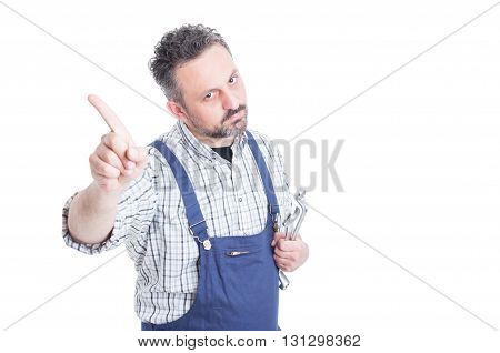 Portrait Of Serious Mechanic Doing No Or Refusal Gesture