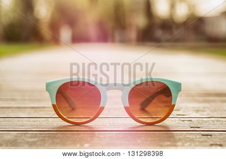 Close-up of retro glasses outside in the park as fashion vintage style concept