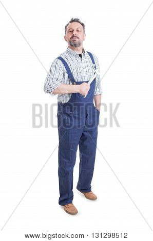 Handsome Mechanic Or Repairman With Spanner Standing And Posing Confident