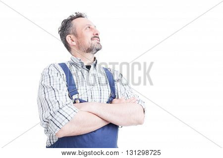 Confident Handsome Mechanic Holding Arms Crossed And Looking Up