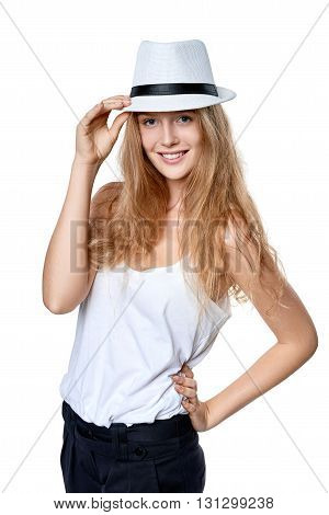 Smiling woman wearing white fedora straw hat over white background