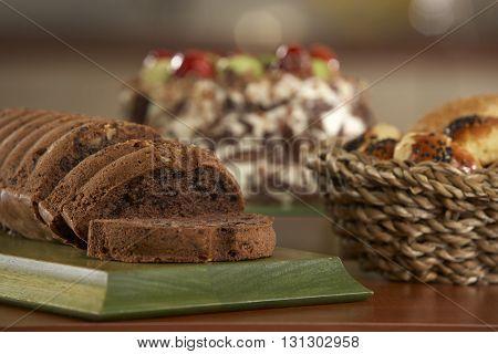cake and sliced cake with chocolate .