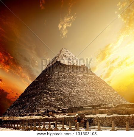 Fiery sunset and pyramid of Khafre near road