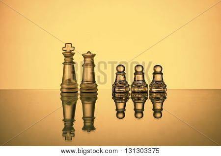 Arrangement Of Chess Pieces On Reflective Surface With Gradient Backlight. Leadership Concept.