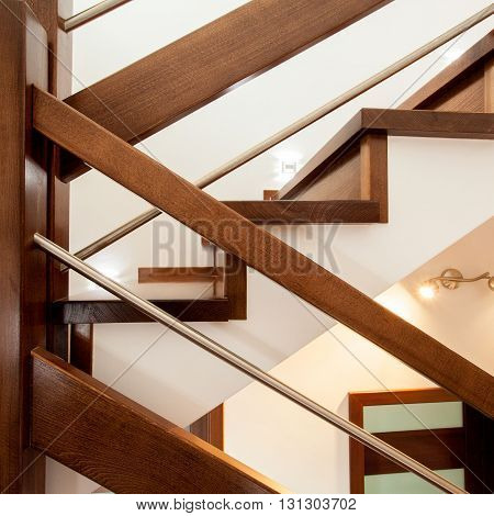 Close-up of  simple wooden stylish stairs at home