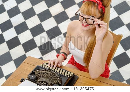 a pretty pinup girl with old typewriter