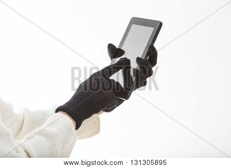 Hands in gloves touching a screen on a tablet isolated against a white background.