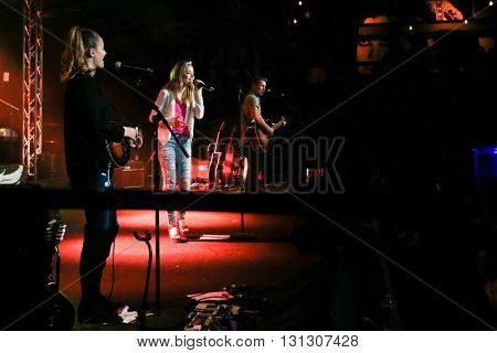 PATCHOGUE, NY-MAR 9: (L-R) Singers Emma Salute, Maddie Salute and Dawson Anderson of Temecula Road perform onstage at the Emporium on March 9, 2016 in Patchogue, New York.