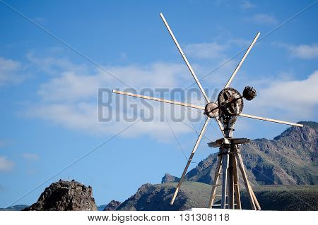 A shot of an old windmill in the country