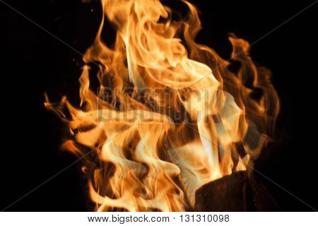 orange flames on a black background fire