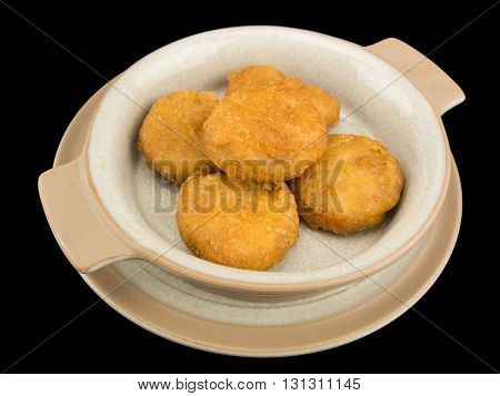 Plate of chicken nuggets isolated on the black background with clipping path