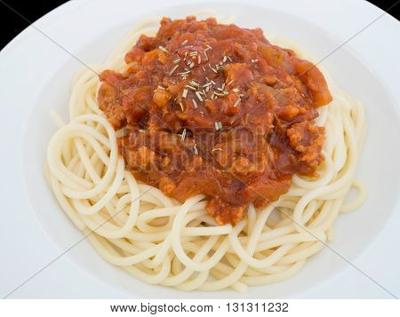 Spaghetti bolognese on a plate isolated on the black background with clipping path