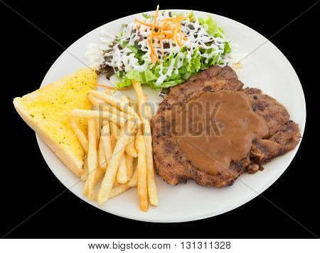 Pork chop steak with french fries bread and Vegetable isolated on the black background with clipping path