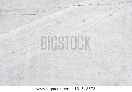 Closeup surface concrete floor with tire tracks texture background