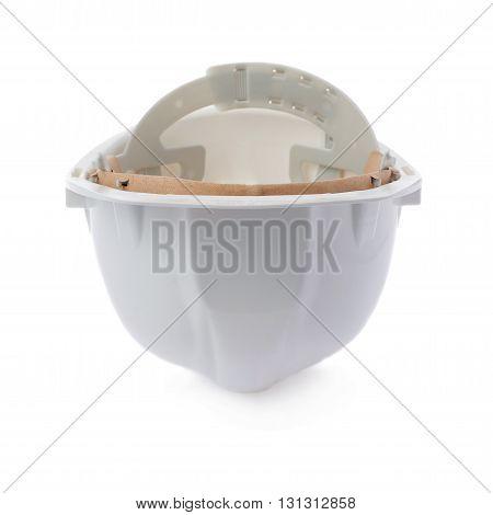 Plastic white safety helmet over isolated white background