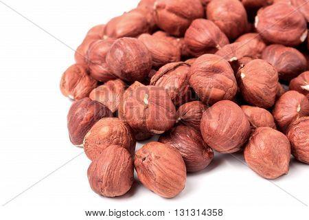peeled hazelnuts isolated on white background macro.