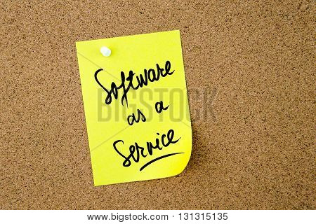 Software As A Service Written On Yellow Paper Note