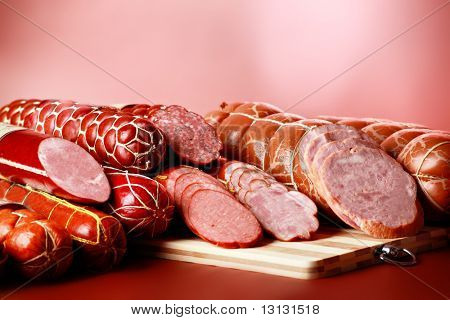 Tasty sausages on the red background.