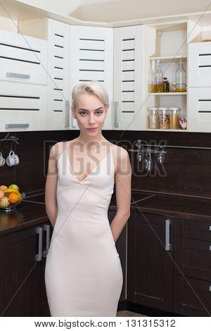 Portrait Vogue model posing in modern kitchen