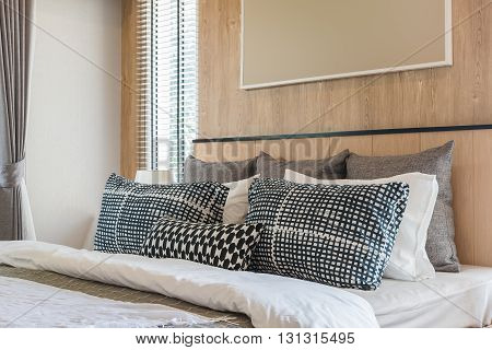 Black And White Pillows On Bed In Modern Bedroom Design