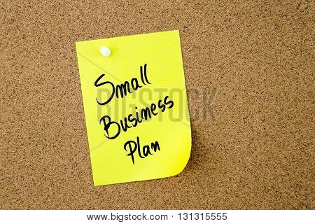 Small Business Plan Written On Yellow Paper Note