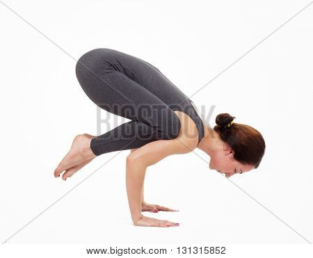 Young woman doing yoga isolated on white