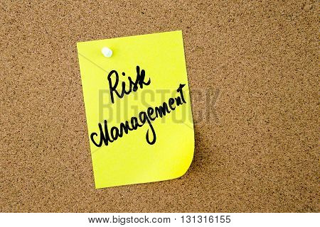 Risk Management Written On Yellow Paper Note
