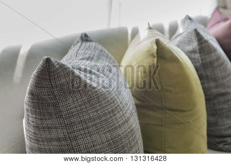 Row Of Pillows On White Sofa In Living Room