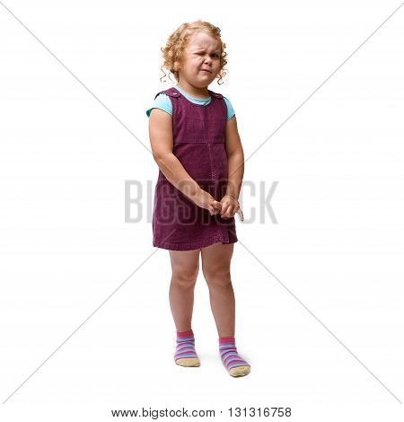 Young little girl with curly hair and one eye closed in purple dress standing over isolated white background
