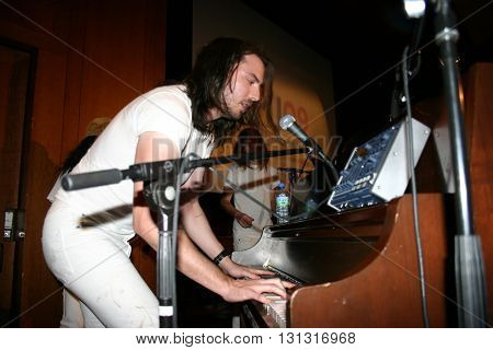 NEW YORK NY: OCT 21, 2009: Musician Andrew W.K. performing with fans during the keynote address for the 2003 CMJ Music Marathon and Arts Festival at New York University