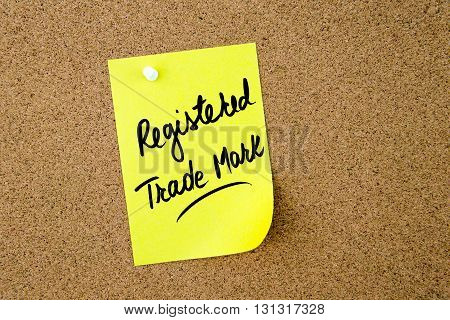 Registered Trade Mark Written On Yellow Paper Note